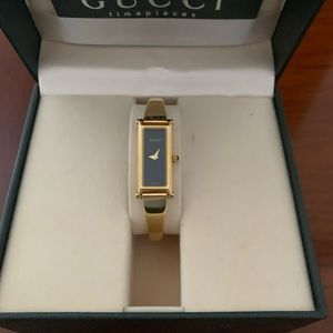 Gucci gold plated stainless steel watch